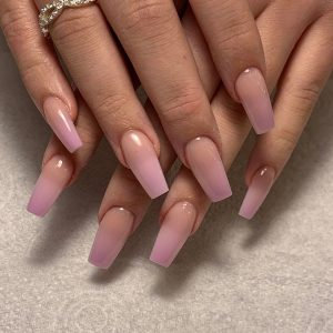 coffin shaped acrylic nail extensions in pale pink colour