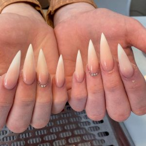 long pointed ombre nail extensions with diamantes