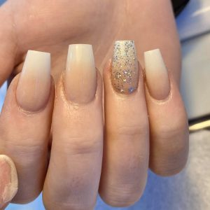 ombre nail extensions with a glittering nail design